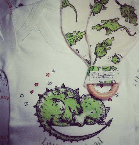 baby dragon babygrow and teether by InkyMotes illustrator Sally Barnett frome bath illustrator illustration bristol illustration